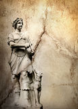 Background with man sculpture. Old stone background with a sculpture man with dog Royalty Free Stock Photography
