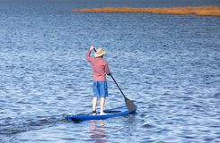 Background of Man on Standup Paddle Board. In water of Pamlico Sound in Salvo, NC on the Outer Banks royalty free stock photos