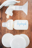 Background of manual breast pump and baby bottle with milk Stock Photography