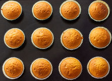 Background of the many baked muffins on a black tray Stock Photo