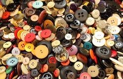 background with many buttons of clothes for sale stock images
