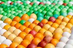 Background many colored eggs closeup Stock Images