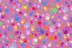 Background of many colored fingerprints on a pink background. Background of many bright colored fingerprints on a pink background Stock Photo