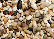 Background with many different colored stones. Background made of many different colored stones stock photos