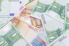 Background of many dollars and euros Stock Photography