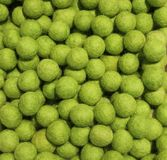 Background of green balls of wool Royalty Free Stock Image