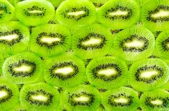 Background of the many kiwi fruit slices Stock Images