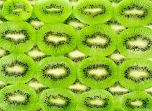 Background of the many kiwi fruit slices Stock Images