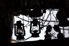 Background of many lit storm lanterns or hurricane lamp Stock Photos
