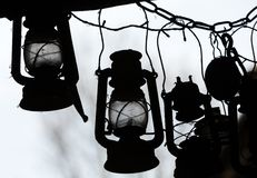 Background of many lit storm lanterns or hurricane lamps Royalty Free Stock Photo