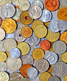 Background of many metallic coins of different countries Stock Photos
