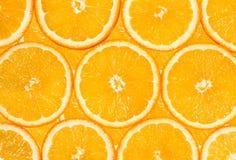Background of the many orange fruit slices Stock Image