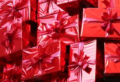 Background of many red gifts. To christmas Stock Photography