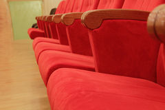 Background of red theatrical red chairs. Background of many red theatrical red chairs Royalty Free Stock Images