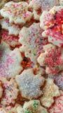 Maple Leaf Sugar Cookies with Sugar Sprinkles. A background of maple leaf sugar cookies with red sugar sprinkles stock photography