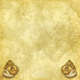 Background with masks and floral elements. A rich vintage golden floral background with venetian masks royalty free stock photos