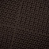 Background of matte black grid with round perforations Royalty Free Stock Photo