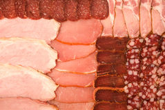 Background of meat. Background of sliced sausage and meat Stock Images
