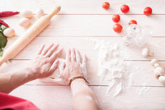 Background of men's hands knead the dough Royalty Free Stock Images