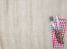 The background for the menu. Canvas tablecloth, fork,knife and napkin for steaks. Is used to create a menu for a steak house Royalty Free Stock Image