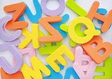 Messy heap of sponge rubber alphabet letters background. Royalty Free Stock Photography