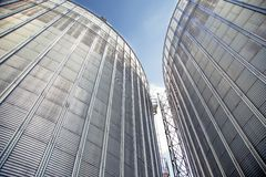 Background, metal barrels granaries on the sky background. A Stock Image