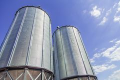 Background, metal barrels granaries on the sky background Royalty Free Stock Photos