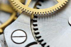 Background with metal cogwheels a clockwork. Macro Royalty Free Stock Images