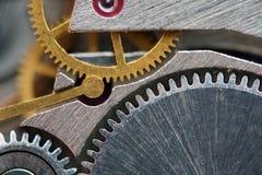 Background with metal cogwheels a clockwork. Macro Stock Photos