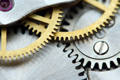 Background with metal cogwheels a clockwork. Royalty Free Stock Images