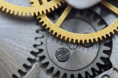 Background with metal cogwheels a clockwork. Macro Stock Images