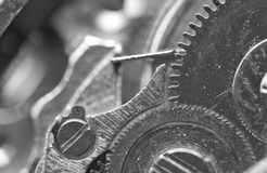 Background with metal cogwheels a clockwork. Macro Royalty Free Stock Image