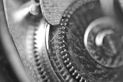 Background with metal cogwheels a clockwork. Macro Stock Photos