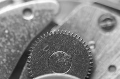 Background with metal cogwheels a clockwork. Macro Stock Photo