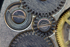 Background with metal cogwheels a clockwork. Macro, extreme clos Royalty Free Stock Image