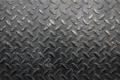 Background of metal diamond plate in black color. Royalty Free Stock Photos