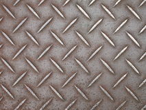 Background of metal diamond plate in brown silver color Stock Photos