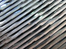 Background metal edges. Silver background or aluminum metal edges . Stacked aluminum rims online Stock Images
