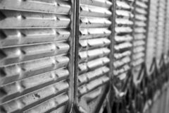 Background from metal gratings stock image