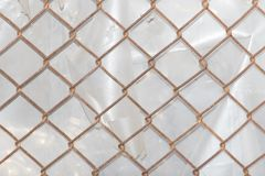 Background of the metal mesh fence. Photo of an abstract texture Stock Image