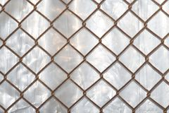 Background of the metal mesh fence. Photo of abstract background Stock Photos