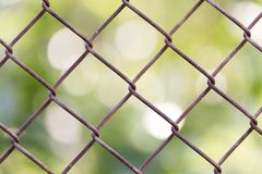 Background of the metal mesh fence. Photo of abstract background Stock Photography