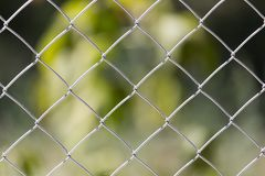 Background of the metal mesh on the nature.  Stock Image