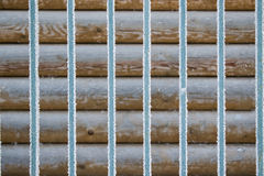 Background from metal rods and logs Stock Photo