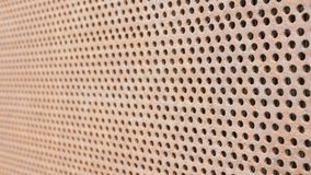 Background metal rusty old car grille. Symmetric holes on the entire surface of the sheet. Moving camera stock footage