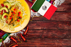 Background: Mexican Flag and Tacos to Celebrate Cinco De Mayo royalty free stock image