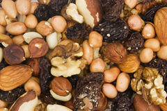 Background of mixed nuts and dried fruits. Background of assorted mixed nuts and dried fruits Royalty Free Stock Photography