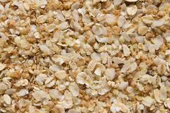 Background of a mixture of rice, oat, buckwheat flakes and flax seeds stock images