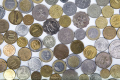 Background of modern coins of different countries. On a white surface Royalty Free Stock Photos