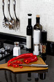 Background of modern kitchen and cutting board. And peppers Royalty Free Stock Photo